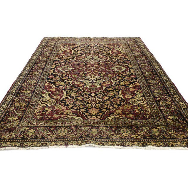 From casual elegance to fresh and formal, relish the refinement as this antique Persian Kerman rug with traditional style...