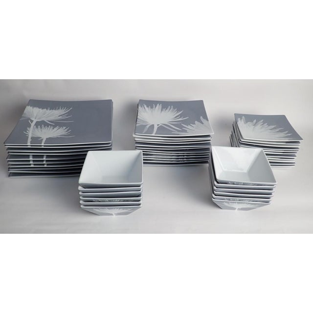 """Large set of CB2 dinnerware featuring spider mums in shades of grey with white botanical. Includes: 10 square 11 3/4 """"..."""