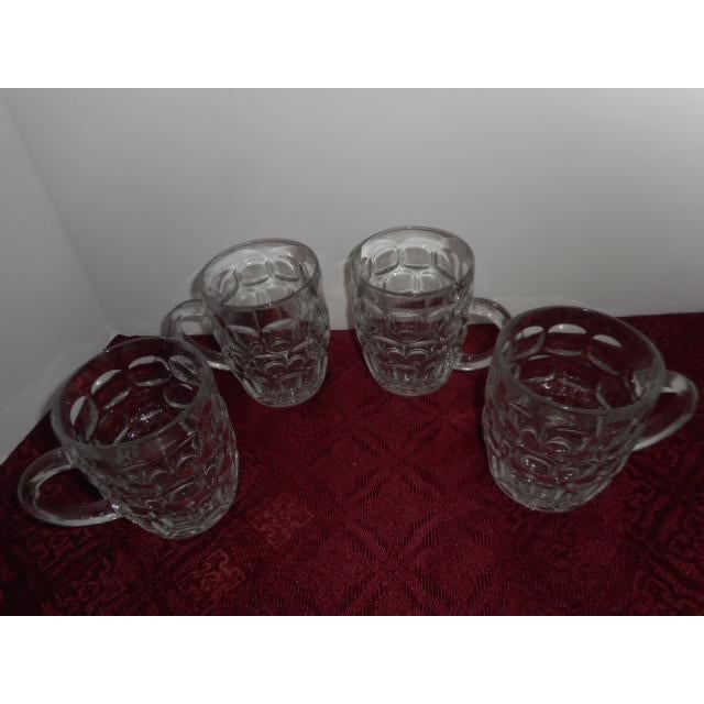 Set of 4 beer mug thumbprint glasses made of very heavy glass. Marked France on each bottom. This is a no spill mug. Looks...
