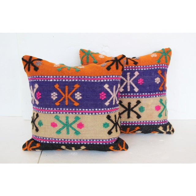 Pair of cushions made from a vintage handwoven Turkish kilim textile. Heavyweight cotton backs. Hidden zipper closures....