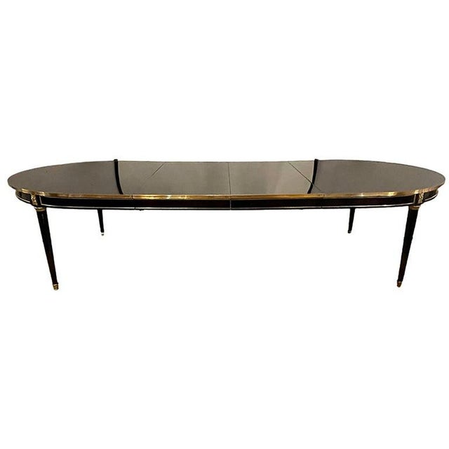 Stunning Jansen ebony dining or conference table in the Louis XVI Manner. Depicting the glitz and glamour of Hollywood...