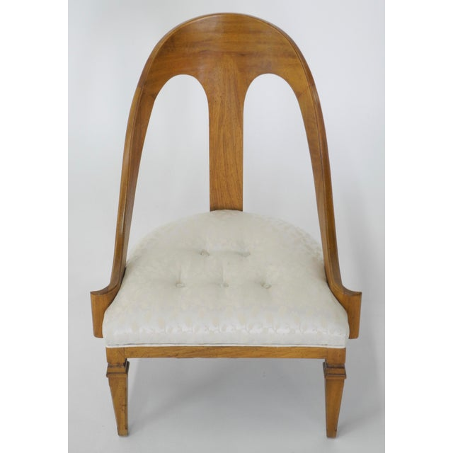 Elegant and Timeless Neoclassical Style Spoon Back Slipper Chair, circa 1950s. This exquisite chair is in perfect...