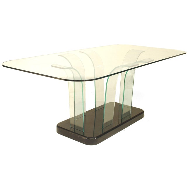 American Art Moderne (1940s) dining table with a large glass top with rounded corners resting on 6 bent glass supports on...