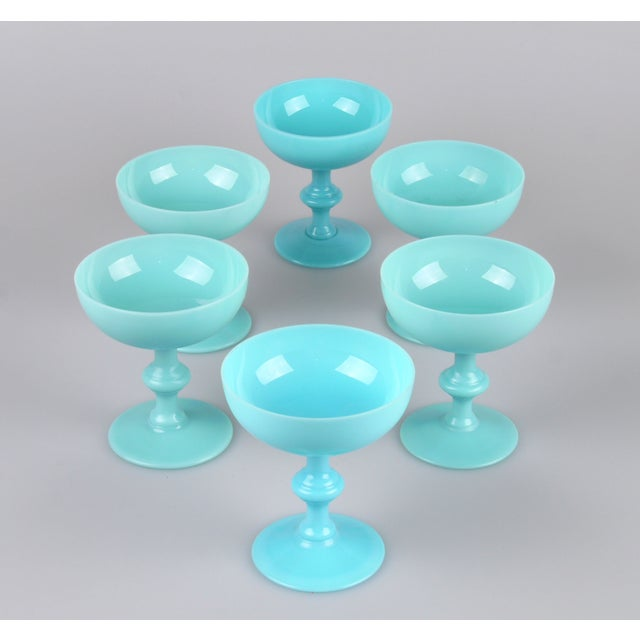 Set of six vintage blue glass sherbet cups. Two cups have a slightly different blue tone.