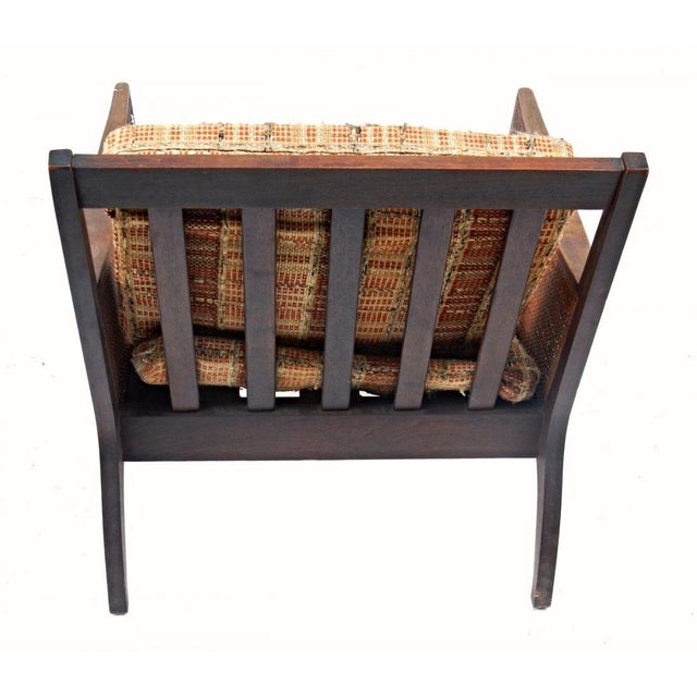 A unique shape lends this stylish wood and wicker mid-century chair a decidedly upscale air, and you will love the...