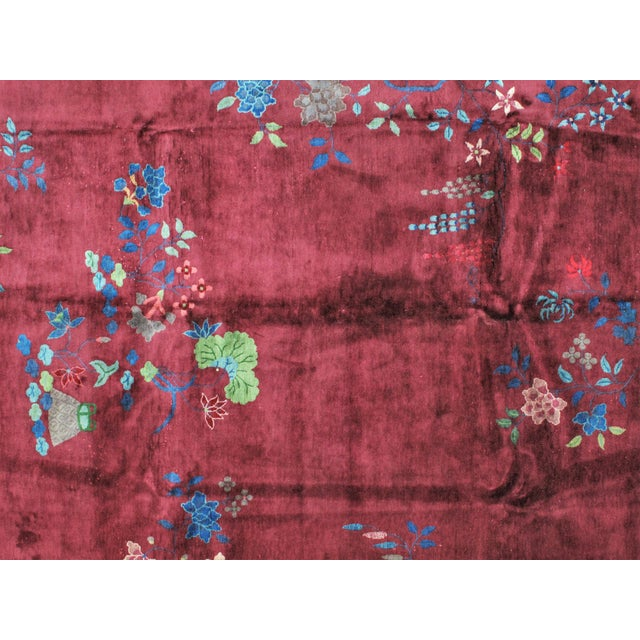 This masterpiece is a wool pile genuine handwoven Chinese carpet. The piece is of the Art Deco period and style.