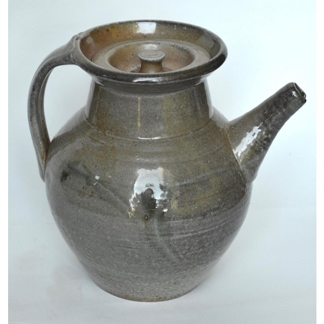 Beautiful large earthenware pitcher, earthy green-gray glaze in the style of Winchcombe pottery. The Winchcombe Pottery...