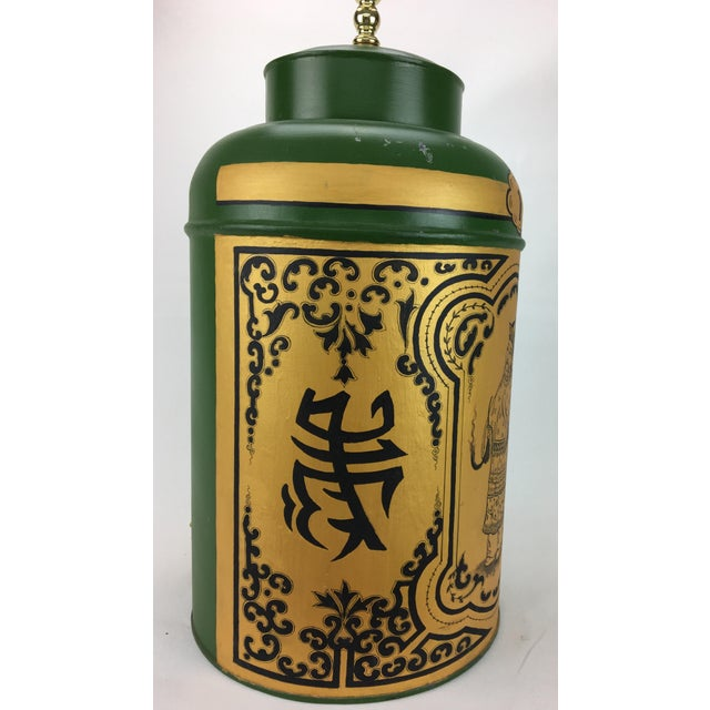 English export chinoiserie tea caddy lamp. Green/gold with Chinese figurine and long life symbols and designs, the number...