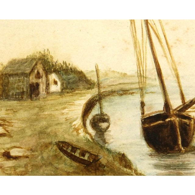 One-of-a-kind watercolor of a peaceful shoreline dwelling and sailing vessel, circa 1900. Displayed on a white mat with a...