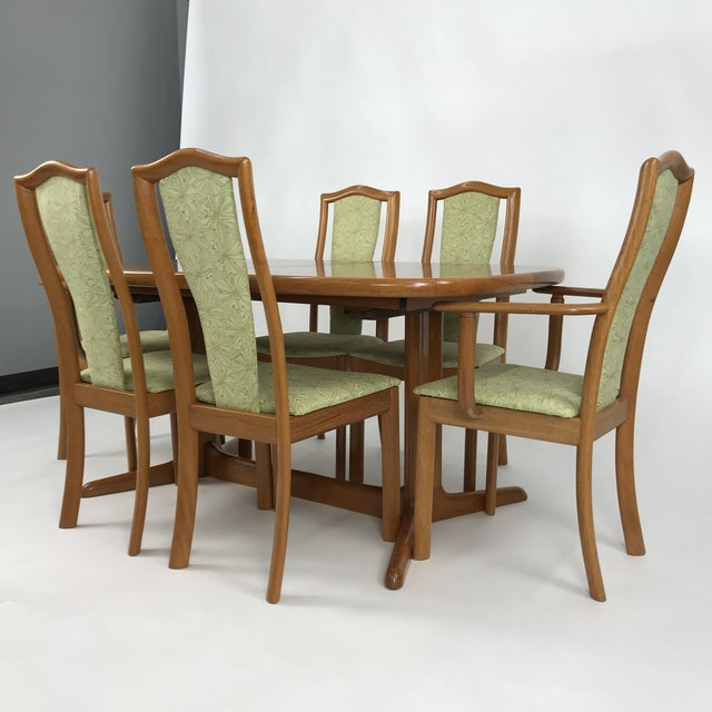Newly restored Danish Dining set by Skovby with 4 standard chairs and 2 armchairs. The chairs have new upholstery done...