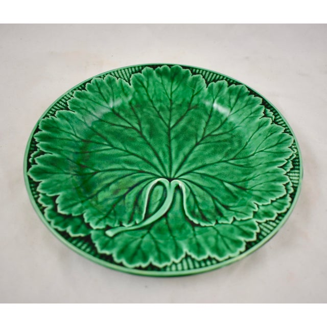 A majolica green glazed plate, from the English firm of Wedgwood. A classic mold showing a single large cabbage leaf...