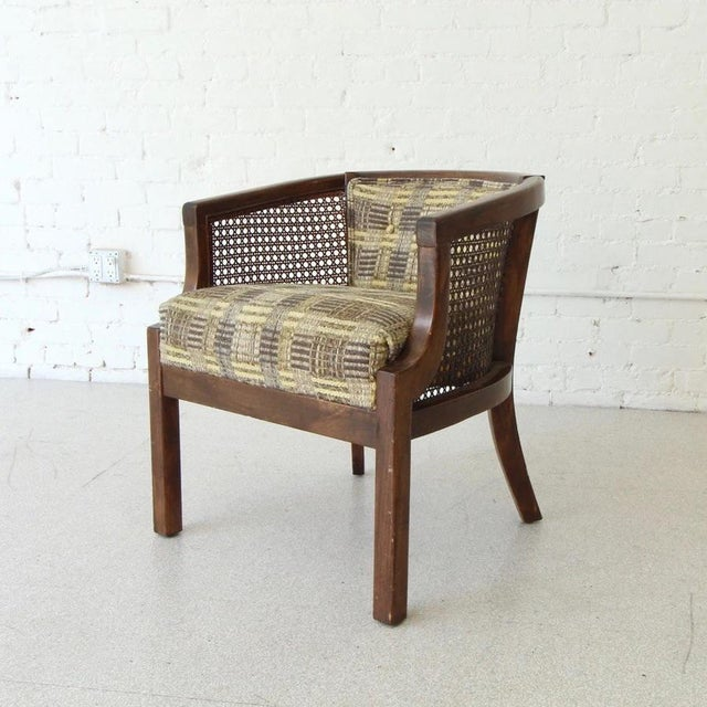This quirky vintage barrel lounge chair is a piece not meant to be passed up! Lovely plaid upholstery and classic caning...