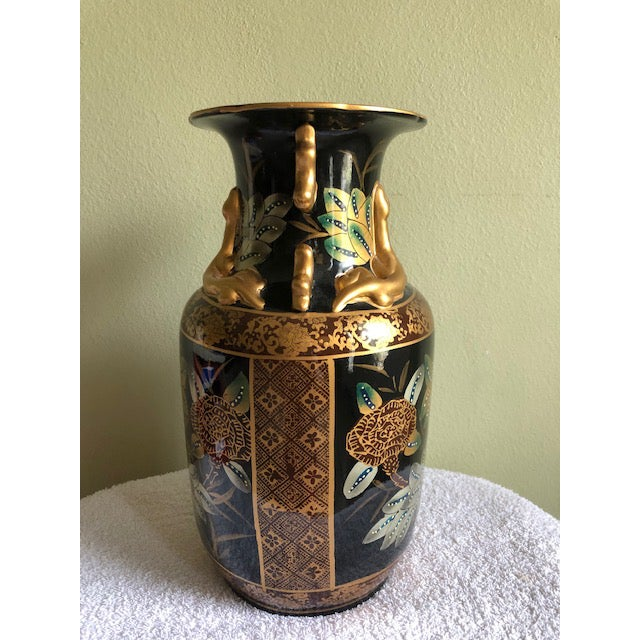 """A beautiful 14"""" , tall Asian style Black and Gold Vase with green and white foliage and gold and silver flowers. Lots of..."""