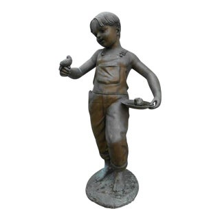 Unique Bronze Statue of a Boy Holding a Bird For Sale