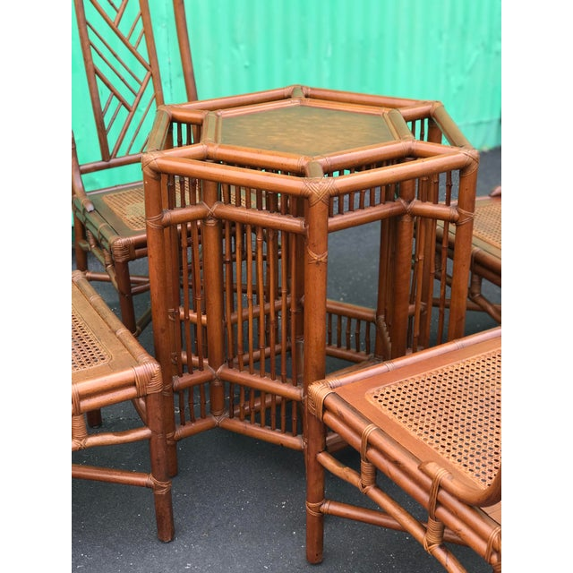 Vintage Brown Jordan rattan table and four Chinese Chippendale chairs with a Brighton Pavilion style. Chairs have had...
