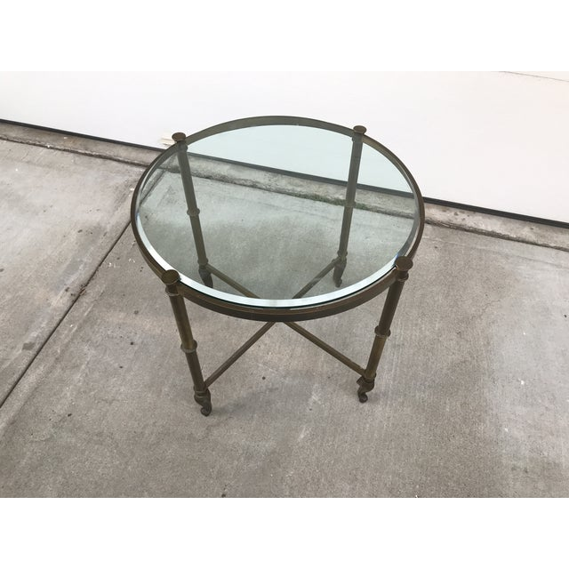 "Vintage 60's regency style circular corner table with queen anne legs. 3/4"" thick glass top with 1/2"" beveled edge. Frame..."