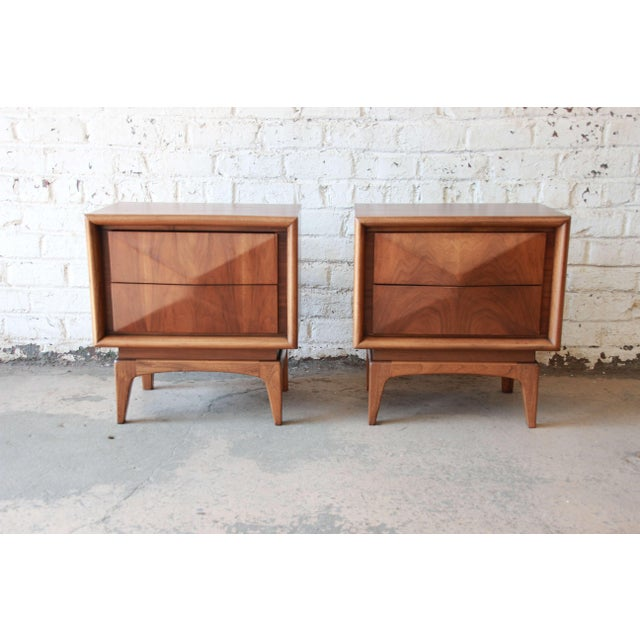 Offering a beautiful pair of diamond front nightstands by United Furniture Co. The nightstands are made from walnut and...