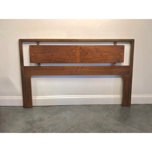 Vintage Lane Acclaim series walnut headboard with classic oversized dovetail inlay. Cut out geometric shape gives the...