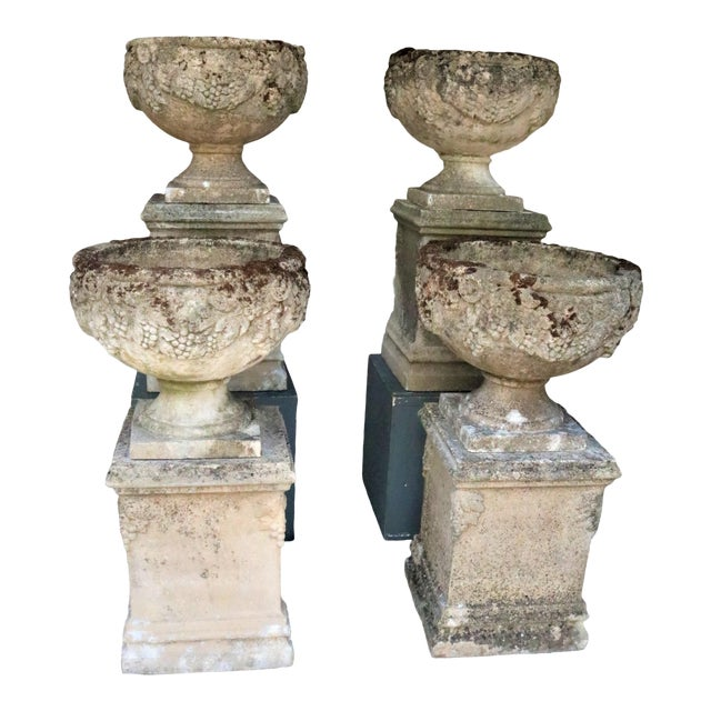 Early 20th Century English Cast Stone Urns on Bases W/ Grape Motif, Set of 4 For Sale