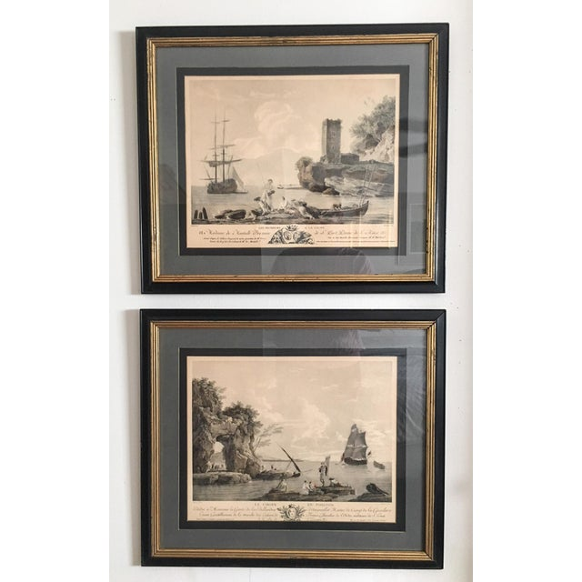 An excellent pair of mid-1800s French nautical framed engravings, consisting of Les Pecheurs a la Ligne (roughly...