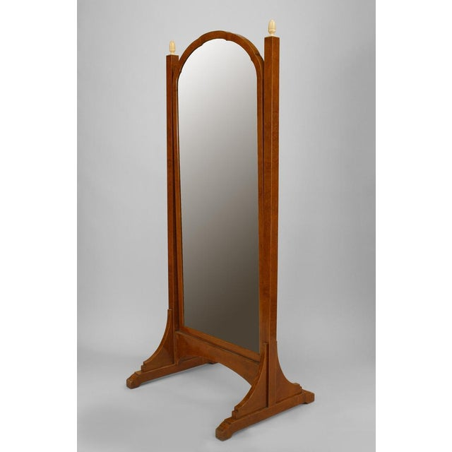 French Art Deco bevelled glass cheval mirror framed in amboyna wood with banded inlaid trim and bone finials.