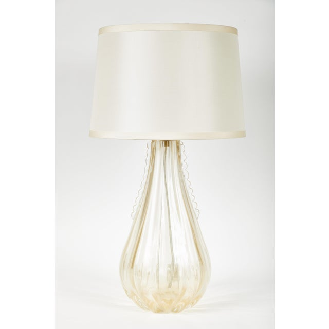 Pair of Gold-flecked Venetian teardrop lamps with ivory pongee silk drum shades. Gourd shaped base with detailing....