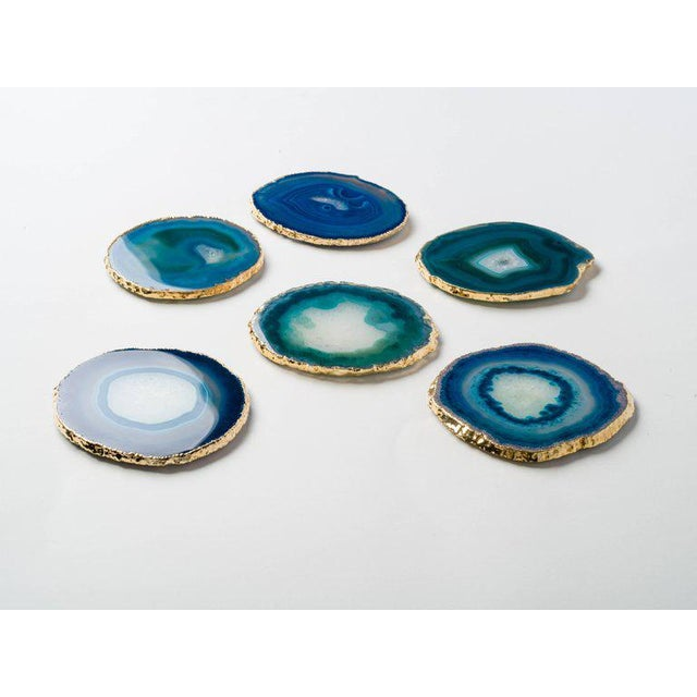 Stunning natural agate and crystal coasters with 24-karat gold plated edges. Polished fronts and natural rough edges. No...