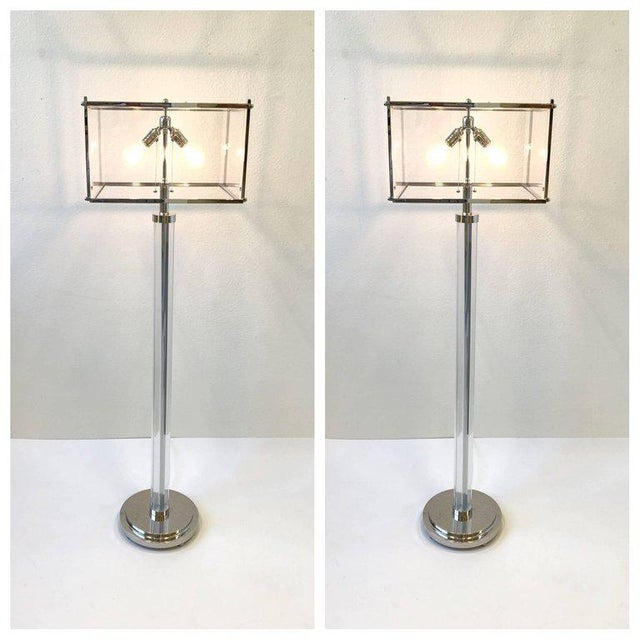 A spectacular pair of clear acrylic and polish nickel floor lamps Design by renowned designer Charles Hollis Jones in the...