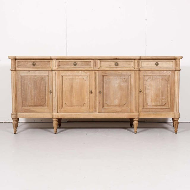 Antique French Louis XVI style enfilade buffet handcrafted in the Île de France region of walnut having a bleached finish,...