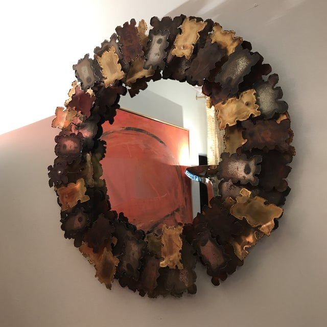 This is a gorgeous brutalist Mirror that has been torch cut and welded with mixed metal. This piece adds such warmth to a...