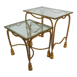 1960s Hollywood Regency Gilded Metal and Glass Turned Rope and Tassels Nesting Tables - 2 Pieces For Sale