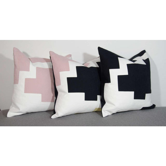 Couture throw pillows by Arguello Casa with abstract designs, inspired by the architectural skyline of New York City....