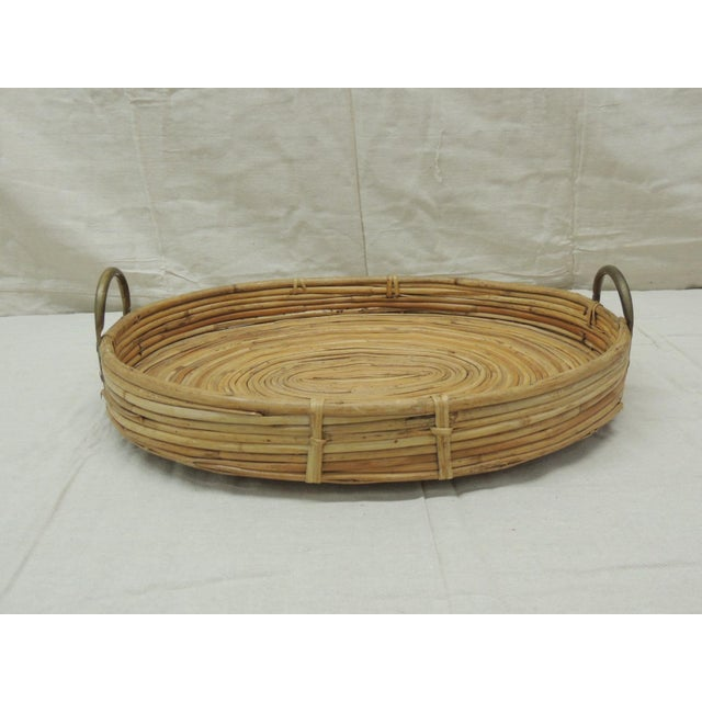 Vintage Bent Oval Rattan Serving Tray with Antique Brass Finished Handles Intricate spiral design at the center. Serving...