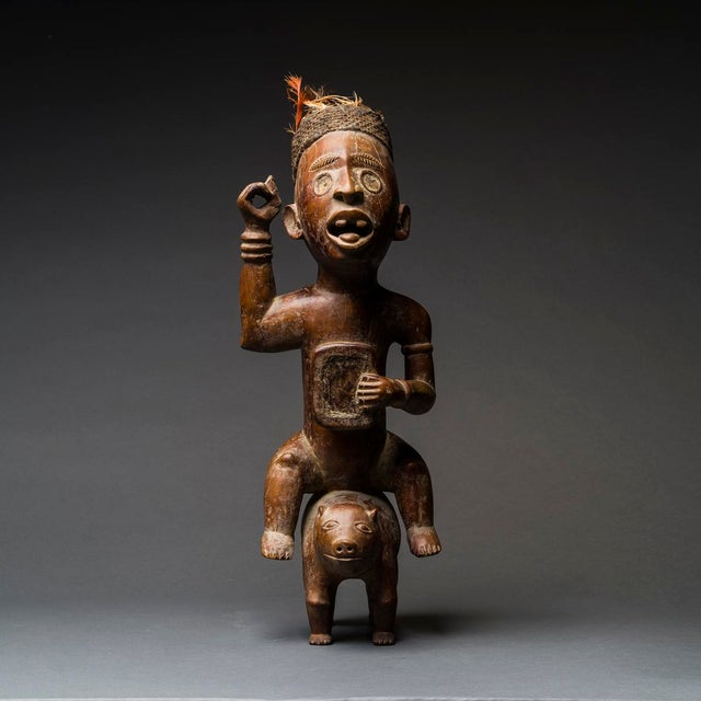 This unusual figure of a man mounted on what appears to be a pig is a magical device from the kongo kingdom. The figure's...