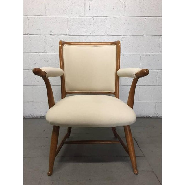 Pair of 1950s French country armchairs. Has an oak frame with a linen-blend upholstered fabric.
