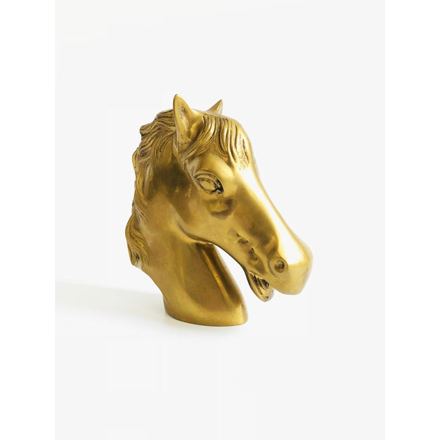 A large vintage brass horse head.