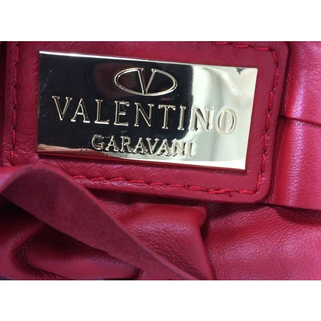 Valentino large red leather ruffle shoulder bag...Padded shoulder strap, gold strap rings, leather tab zipper pull...Deep...