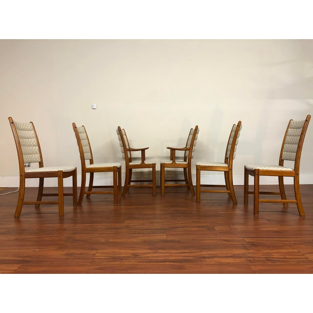 Set of six mid century teak dining chairs designed by Johannes Andersen for Uldum Møbelfabrik, made in Denmark. There are...