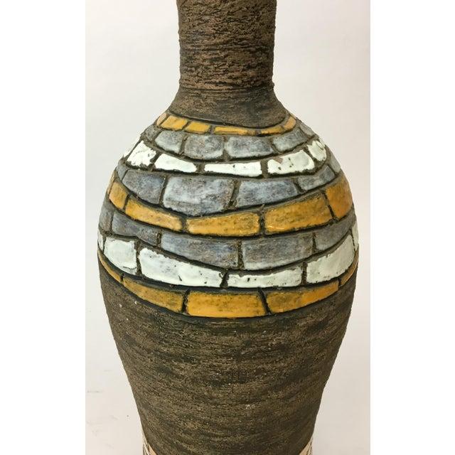 Terrific mid century Italian ceramic lamp, designed by Aldo Londi for Bitossi. Love the brick-like pattern and texture.