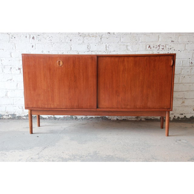 Offering a nice Danish teak sideboard credenza. This piece has a nice Scandinavian design with very unique shelving and...