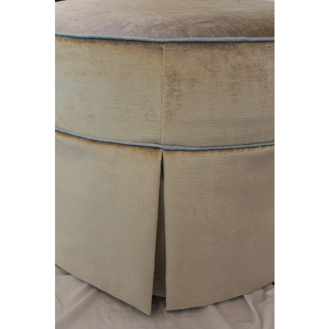 The new round ottoman with swivels is covered in the chic Brussels velvet fabric color dove trimmed with 100 percent silk...