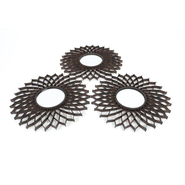 Set of three French, 1970s iron sun mirrors in the manner of Raymond Subes. The condition is very good and shipping...