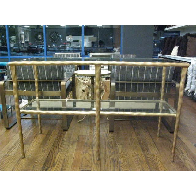 Shelved console with clear, tempered glass. Table is handmade by Jamie Young. Color size and shape will slightly vary.
