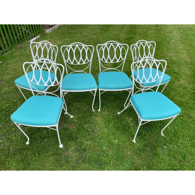Set of six quality heavy iron patio dining chairs by Woodard. The chairs feature water resistant turquoise fabric seats...