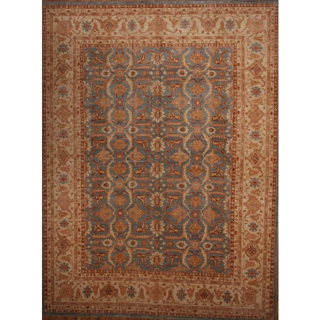 All over floral beautifully hand-knotted wool area rug in slate/grey/orange/burnt sienna.