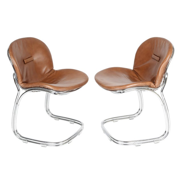 """This set of """"Sabrina"""" chairs was designed by Gastone Rinaldi for Italian maker RIMA. A curvaceous tubular chrome frame..."""