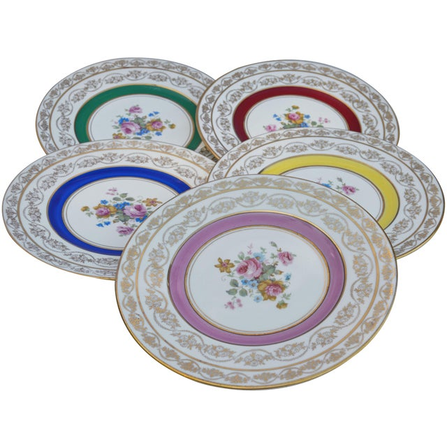 Set of five vintage golden porcelain plates hand-painted with intricate floral pattern, ornate gold rims and colorful...