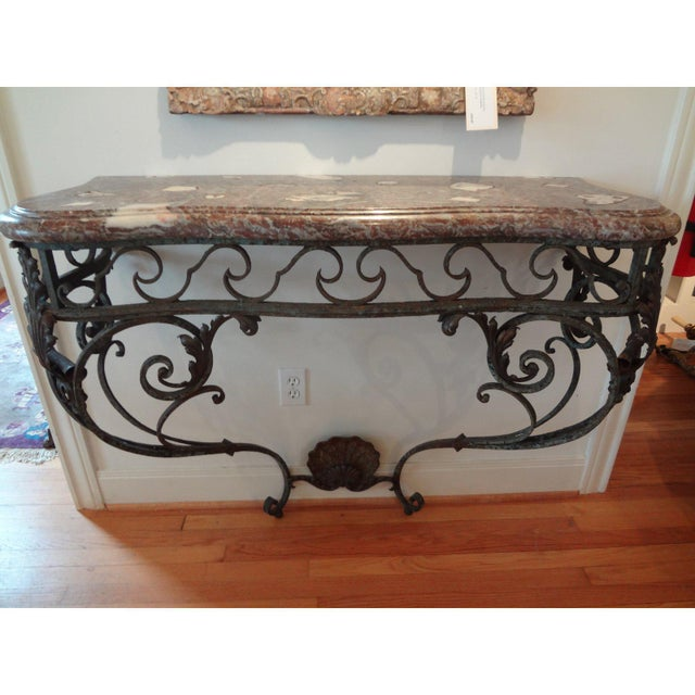 Stunning early 19th century French Regence hand-forged wrought iron console with shell design with original marble top....