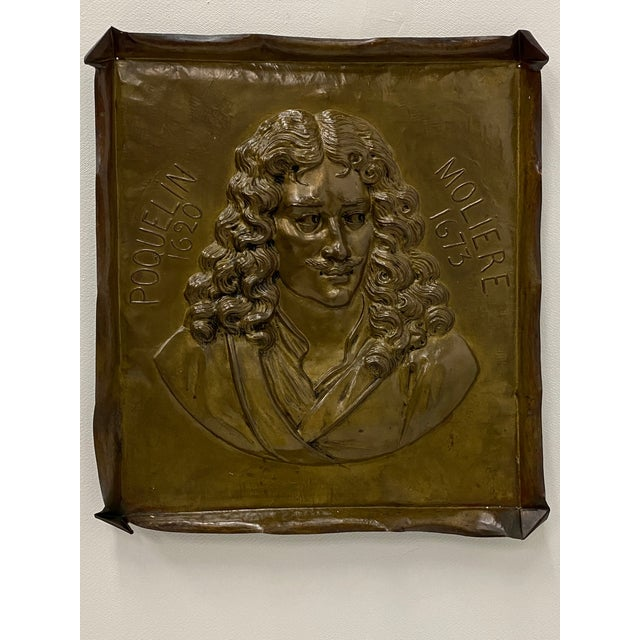 A wonderful brass wall plaque having relief image of the poet Moliere.