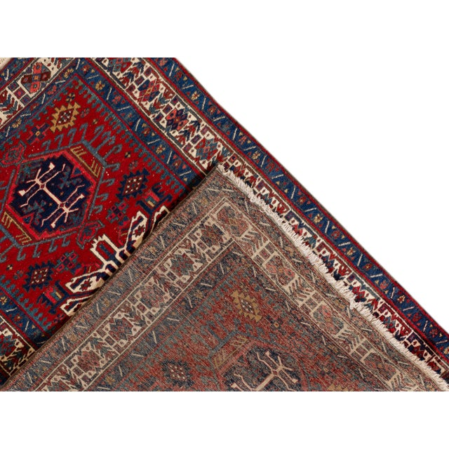 Vintage Persian Heriz Rug with a geometric medallion design. This piece has great detailing and a beautiful design, it...